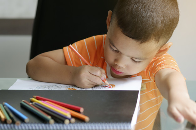 cute boy drawing with color pencils kid learning concept 1384 256