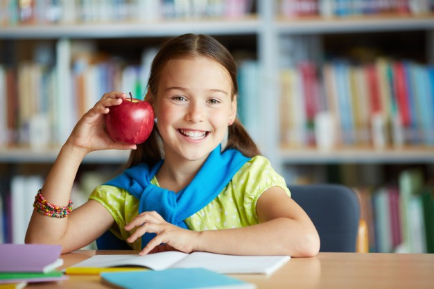 smiling girl with an apple 1098 2602