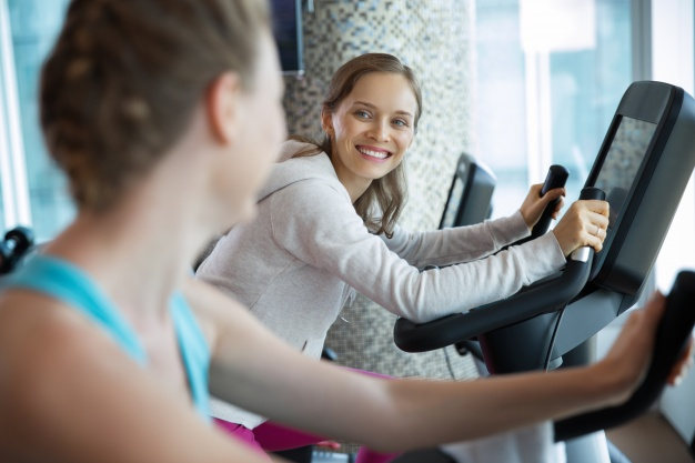 women smiling on a cardio machine 1262 714